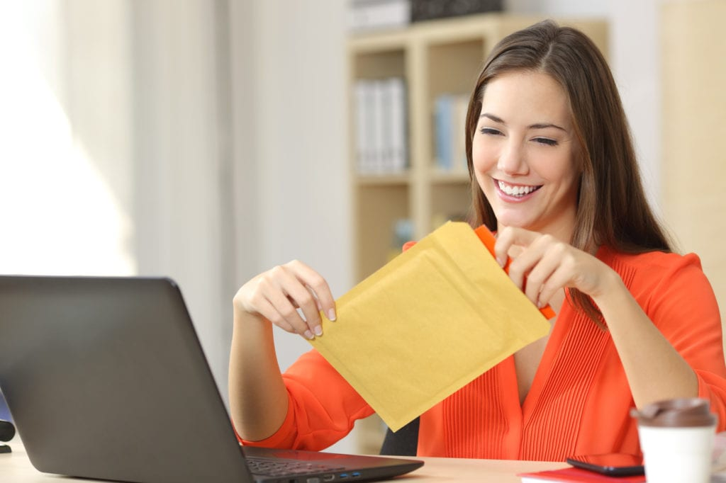 Woman sealing postage for meter